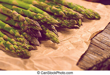 Asparagus on paper bag - Fresh asparagus on paper bag on...