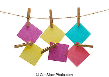 notes on a rope with clothespin on a white background