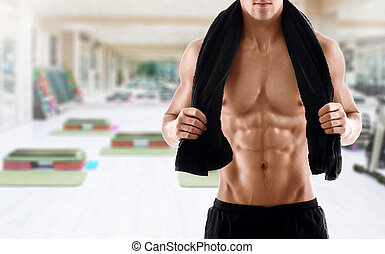 Sexy body of muscular man in gym