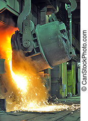 Working in a foundry, hot metal flowing