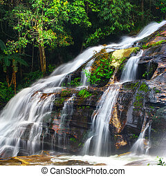 Waterfall at tropical rain forest. Thailand