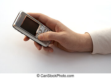 A hand dialing a cell phone