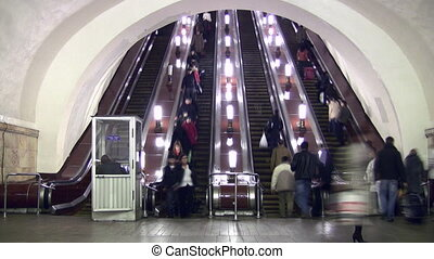Crowd people and subway escalator. Time lapse.