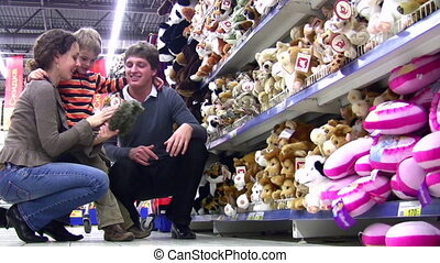 family with boy in toy shop