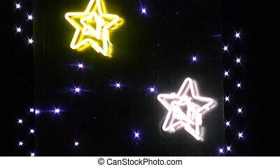 Blinking neon stars