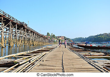 Antique bamboo bridge - People go to travel Antique bamboo...