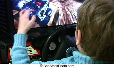 Boy drives on play machine