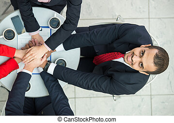 Business - Top view of young man at business meeting, while...