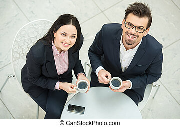 Business - Portrait of a two young business colleagues...