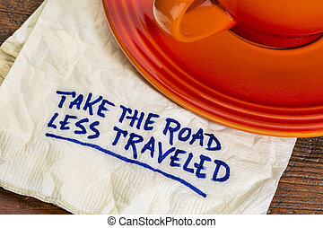 take the road less traveled - handwriting on a napkin with a...