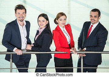 Business - Portrait of smiling, successful international...