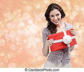 Pretty woman hands a present with white bow - Pretty woman...