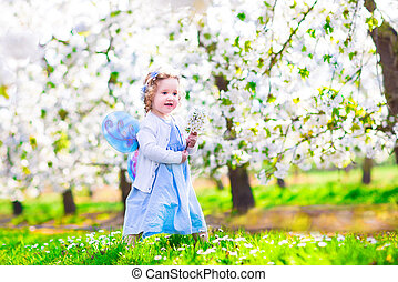 Little girl in apple garden - Adorable toddler girl with...