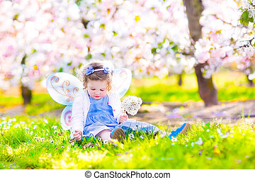 Little girl in blooming garden - Adorable toddler girl with...