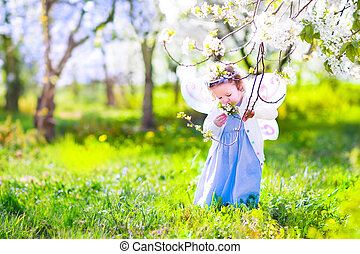 Little girl in cherry garden - Adorable toddler girl with...