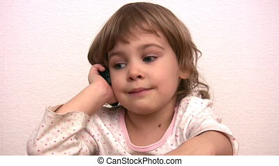 Little girl talks by phone