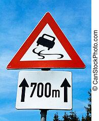 road sign skidding - warning risk of skidding on slippery...
