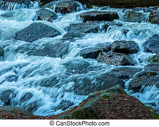 creek with running water - a creek with rocks and flowing...