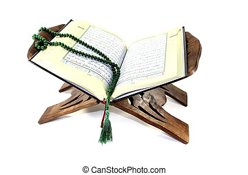 stand with an opened Quran and rosary