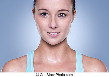 Smiling woman  - Portrait from a young and sporting woman