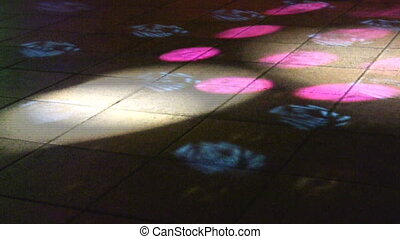 Light spots on floor in night club
