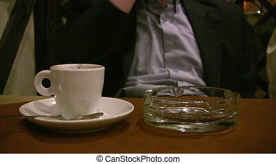 man hand with cup coffee and cigarette