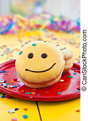 Donut with funny smiley face - Donut with yellow frosting...