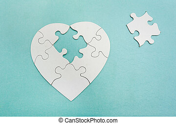 Puzzle piece - Heart shaped puzzle with missing piece...