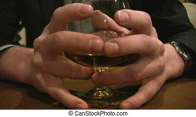 fingers on cognac glass - Fingers on cognac glass