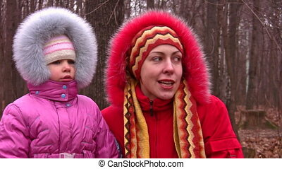 mother with girl in fur clothes - Mother with girl in fur...