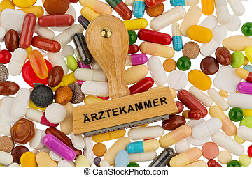 stamp on colorful tablets, symbolic photo for medical...