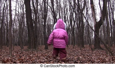 behind walking father and little girl in winter park -...