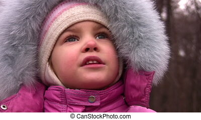 little girl talking in winter park, closeup - Little girl...