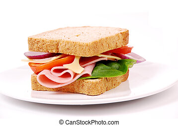 Healthy ham sandwich with cheese, tomatoes on white...