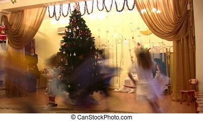running children in kindergarten on New Year holiday -...