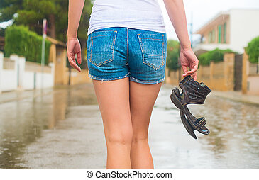 Woman enjoying walking in the rain