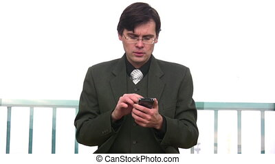 businessman with pocket pc - Businessman with pocket pc