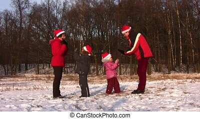 dancing family of four in winter park - Dancing family of...