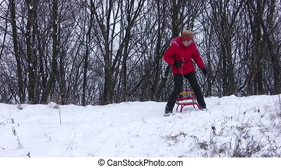 woman on sled strikes camera - Woman on sled strikes camera