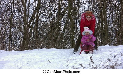woman with little girl on sled - Woman with little girl on...