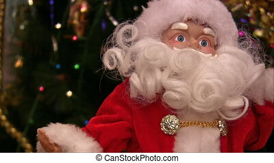 New years Santa rotating near christmas tree