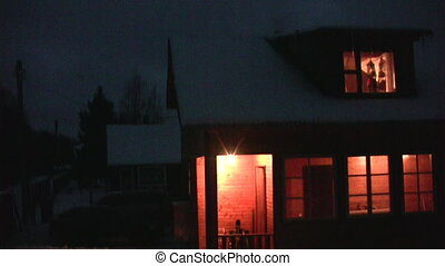 Light in window of house at night