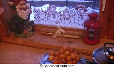 Meal prepares near by window with goblin and snowmen