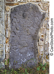 Carved stone at the ruins of Monte Alban in Oaxaca, Mexico