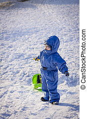 boy with sledge on snow