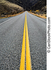 Curved Road with Double Yellow Lines - Detail of road with...