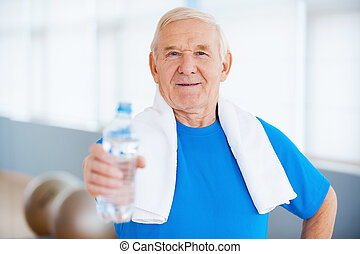 Stay healthy Happy senior man with towel on shoulders...