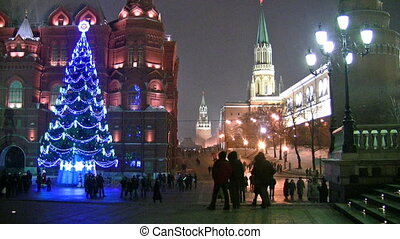 Christmas tree blazes lights on street in Moscow