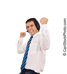Businessman releasing stress listening to music -...