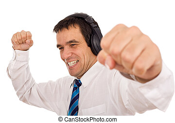 Businessman releasing stress listening to music and...